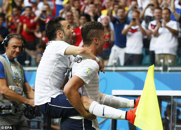 Piggy-back to last-16?: Mathieu Valbuena (left) jumps on Giroud after extending the lead to 3-0