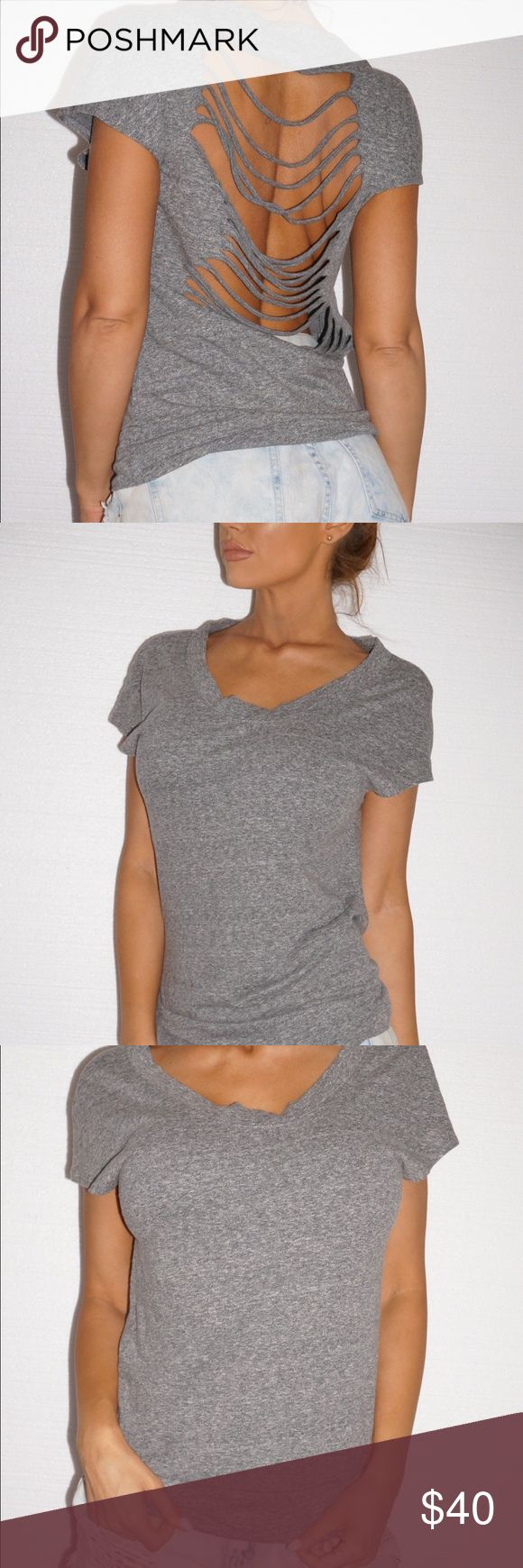 Super sexy Gray BEBE ripped shirt Thick shirt/sweater type material to hide nips so you can go bra less :) this shirt is LIFE !!! Fits XS-M bebe Tops