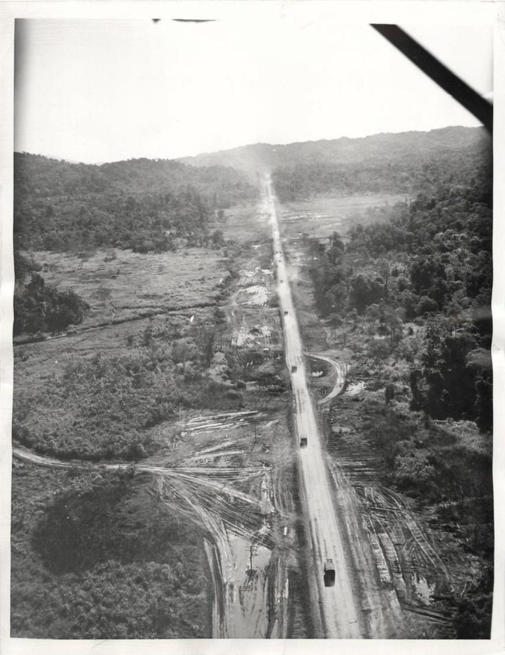 1945- U.S. convoy moves along the Burma-Ledo highway as it approaches Myitkyina, Burma.