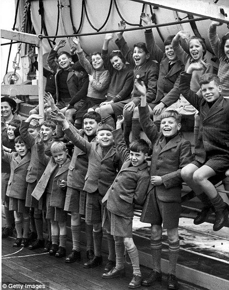 Dreams: Children hopeful of a new life smile and wave as they board a boat for Fairbridge Farm School in Western Australia only to become young slaves