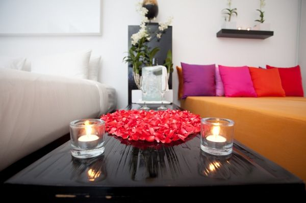 Romantic and simple bedroom idea with candles and rose petals
