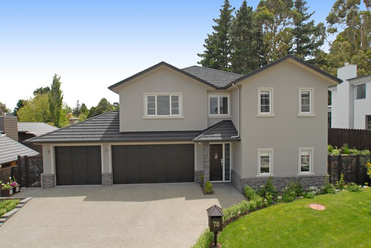 Neutral painted plaster finish contrasting against a dark roof and garage doors (ID 686)