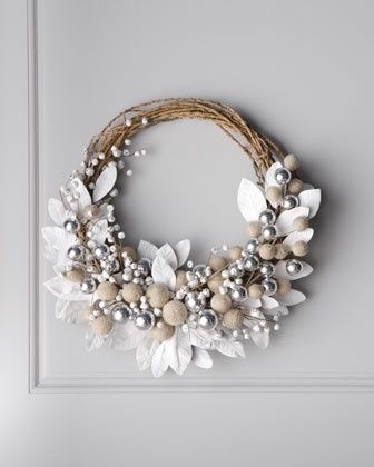 White Wreath with Jingle Bells at Neiman Marcus  Jingle-bell berries in white mixed with natural-hued twigs form a festive Christmas wreath. 140.00!!! I really think we can make this for a quarter of that or less!! Pretty...but not 140.00 pretty! in my opinion