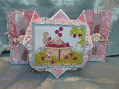 I made the card base the other day in the card fold workshop that I taught so I thought I may as well decorate it. The image is a House Mouse stamp from Joanna Sheen coloured with Promarkers and the papers are ones that I made myself with paint, fairy liquid and a straw for a bubble effect, I have then just decorated with some lace, flowers, ribbon, pearl bead sprays and Cheery Lynn corner die cuts.  Forgot to add the link to my tutorial on this fold you can find everything on how to make…