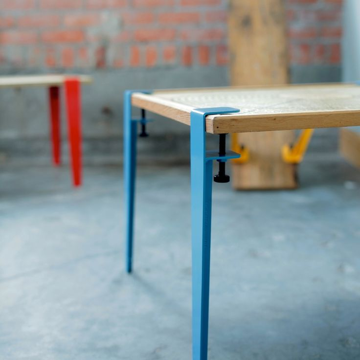 """The Floyd Leg is a tool that allows you create a table from any flat  surface by clamping on the legs.      * Ideal for coffee tables.     * Quantity of 1 set contains 4 legs.     * 16"""" (40.5 cm) coffee table height.     * Powder coat finish.     * Works with materials up to 2"""" (5 cm) thick.     * For medium/light use.     * Carrying case with shoulder strap included.     * Check out our FAQ for more specifications  Ships Out Next BusinessDay"""