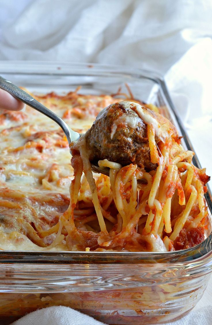 Cheesy Baked Spaghetti and Meatballs is a great way to serve this family favorite comfort food! A simple casserole made with layers of pasta, marinara sauce, cheese and meatballs!!