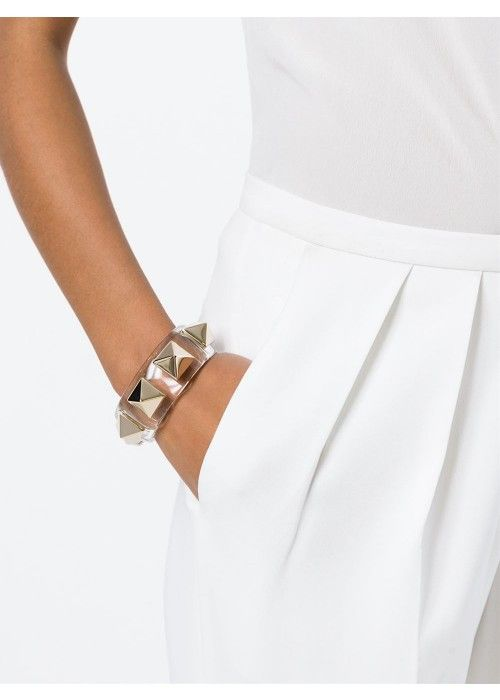 White metal and plastic 'Rockstud' cuff from Valentino Garavani featuring a transparent design and gold-tone Rockstud embellishments.