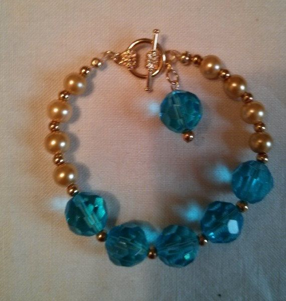 Blue Glass and Gold Pearl Bracelet by treasuresbycathy on Etsy