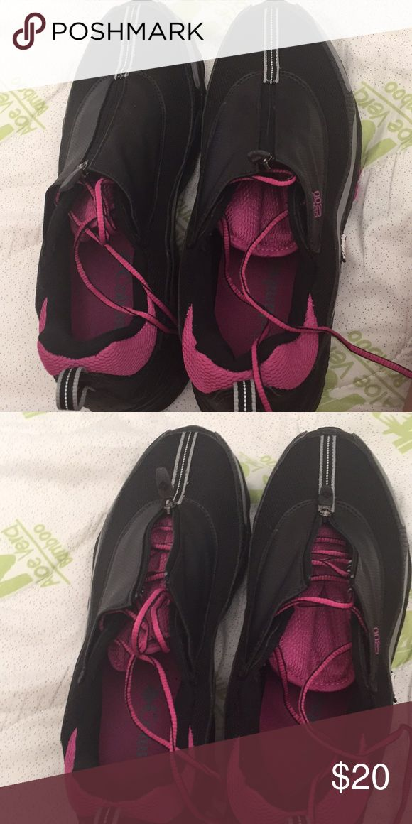 Columbia Black and Purple Zipped Tennis Shoes Columbia black and purple tennis shoes. They do have a zipper that covers the purple shoe strings. Never worn. Size 11 Columbia Shoes Sneakers