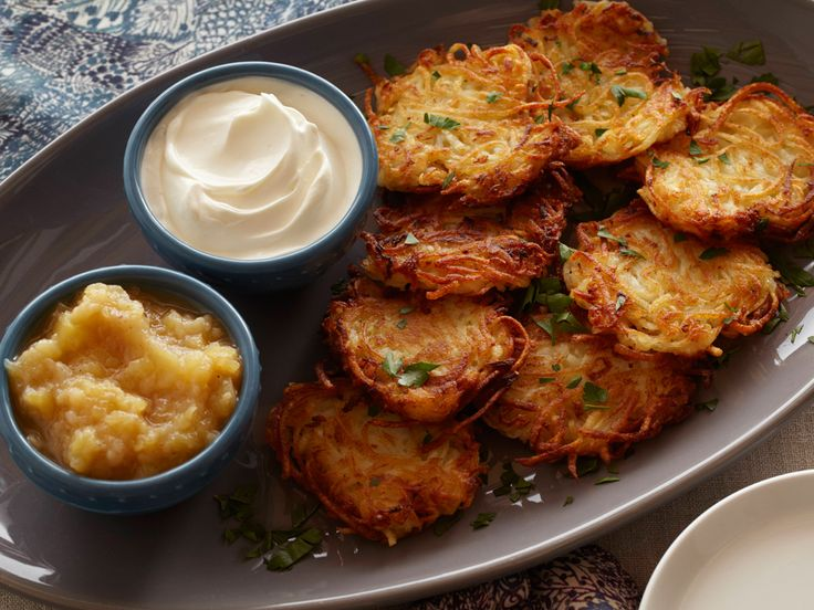 Potato Latkes from FoodNetwork.com....Fried and crispy on the outside but soft on the inside, these classic latkes will help ring in the Hanukkah celebration. We serve ours with a spiced apple-pear sauce and sour cream.