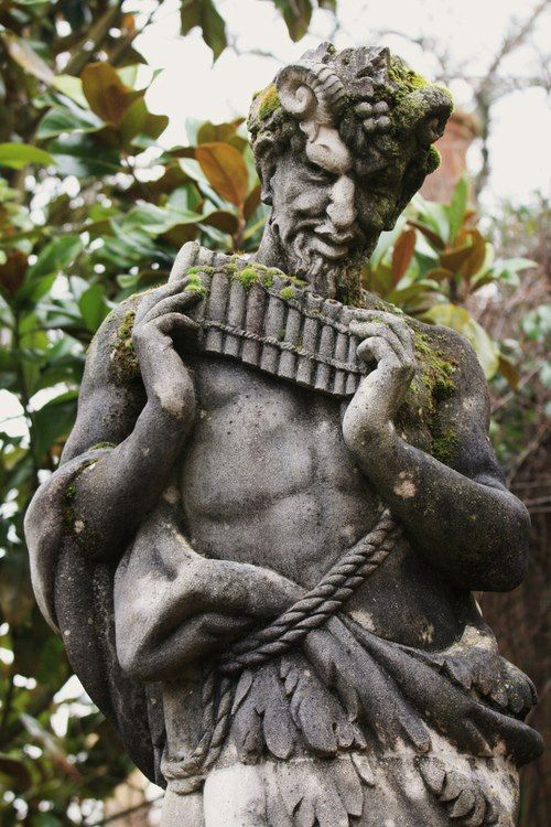A Statue Of Pan (the Faun), At Wisley Gardens, In The UK.