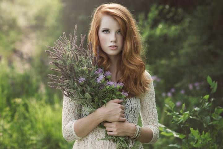 redhead with a flower bouquet.