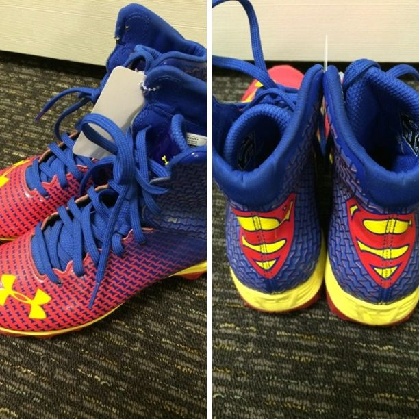 Under Armour Cleats, size 4 - Under Armour Superman Cleats, size 4. Click the link below to see more of the great merchandise available at Lily Pads! - $18.00