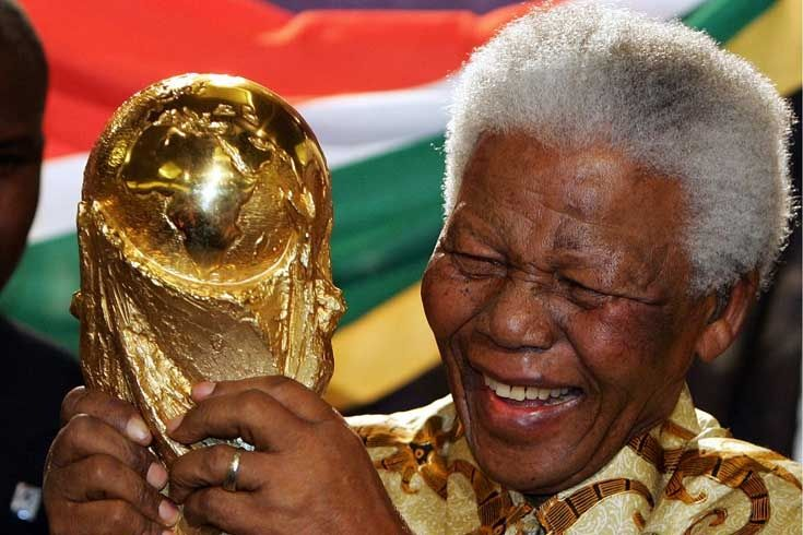 Nelson Mandela just before he retire at headquarters holding the world cup trophy