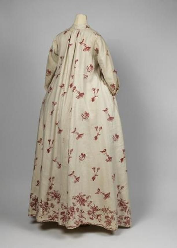Huiskleed of contouche van linnen met motieven op witte grond en contouren in rood | Modemuze