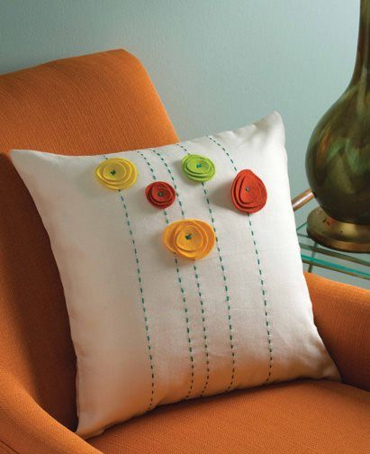 Simple hand embroidery and felt flowers add pop to this pillow by Stefanie Berganini, from Stitch Fall 2014.