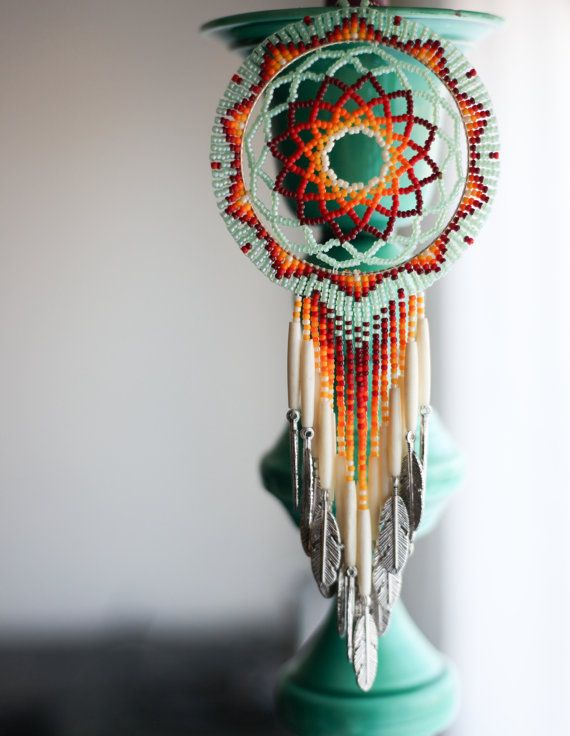 This is a handmade fully beaded dreamcatcher. It measures 10 1/2 from top to bottom and is 3 1/2 wide. It is made using size 11 TOHO beads. The