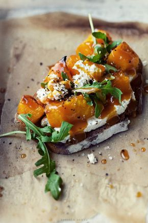 bruschetta with roasted pumpkin, white cheese & arugula 2 slices of toasted breadwhite cheese [ie. ricotta, gruyere, goat] arugularoasted pumpkin*orange-ginger syrupsea salt & freshly ground pepper cover toasted bread with white cheese and roasted pumpkin. sprinkle with arugula and pour ginger syrup. season with salt and freshly ground black pepper. *orange-ginger syrup8 oz orange juice1 tsp honey 1 tbsp freshly grated ginger pour ingredients in saucepan, simmer for about 15 minutes
