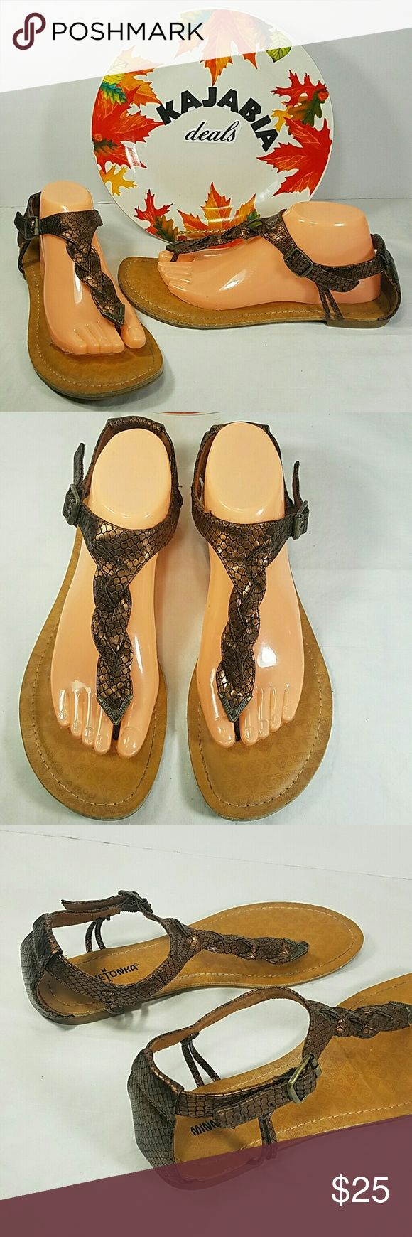 NEW LISTIMG💥MINNETONKA Sandals. Size 10 Excellent condition Minnetonka sandals Size.. 10 Pre owned. No rips. No spots Color.. cooper and tan Fabric..all man made materials  Great preown condition. With a lot of life left.  Perfect to wear all spring and summer season. Only signs of wear are in soles, other than that perfect condition  Perfect for any occasion!!  🚫NO TRADES 🚫NO MODELING 🔵REASONABLE OFFERS WELCOME !! Minnetonka Shoes Sandals