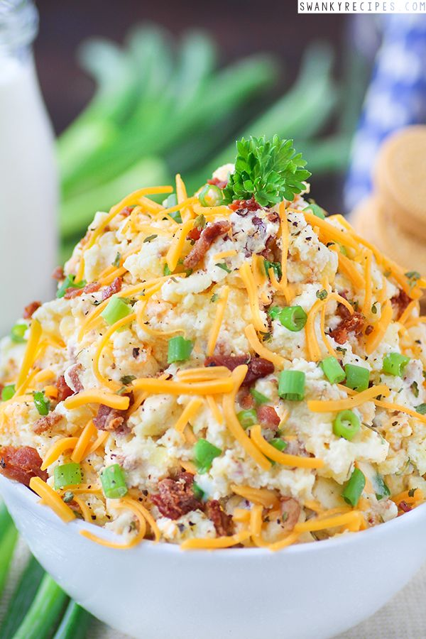 Chunky Honey Gold potatoes mixed with sour cream, cheddar cheese, green onions and bacon perfect for BBQ's, holidays and dinner. Full recipe