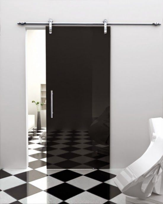 black stained glass doors with white wall