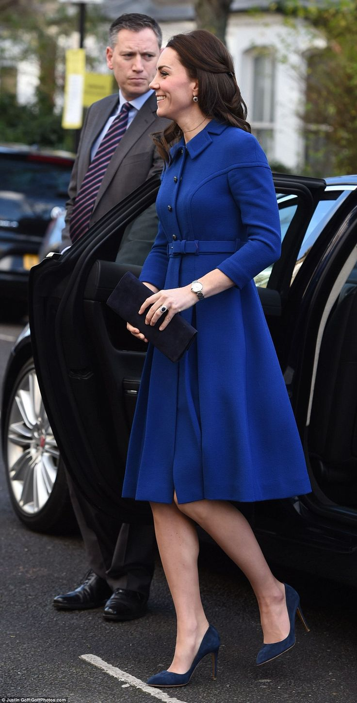 The Duchess of Cambridge looked elegant in a belted blue coat by Eponine as she arrived at...