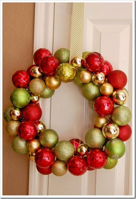 Ornament Wreath - So that's how they do it!!! I'm so making one of these this year.... maybe even 3 (since we have 3 doors).