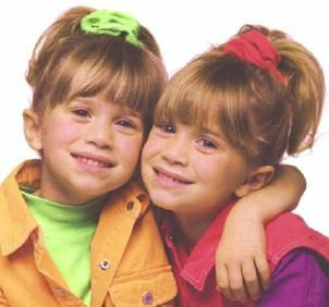 Children's clothing on Mary Kate and Ashley Olsen in the 1990s.  Children's clothing featured bright colors, overalls,  and scrunchies and bows in the hair.
