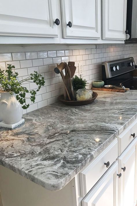 Viscount White Granite Countertops With A Subway Tile