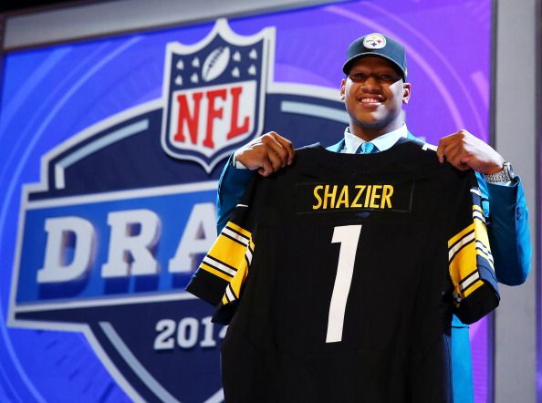 Ryan Shazier of the Ohio State Buckeyes poses with a jersey after he was picked #15 overall by the Pittsburgh Steelers during the first round of the 2014 NFL Draft at Radio City Music Hall on May 8, 2014 in New York City