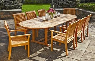 "Essex Oval Extension Table -  Invite a small group or expand your outdoor dining invitation anytime.  29"" H, 45"" W, 80"" L.  With extensions 114"" L.  Teak."
