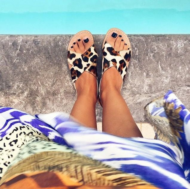 "Chilling in style! ""Melina"" leopard sandals by the pool! Captured by Voguevictimblog."