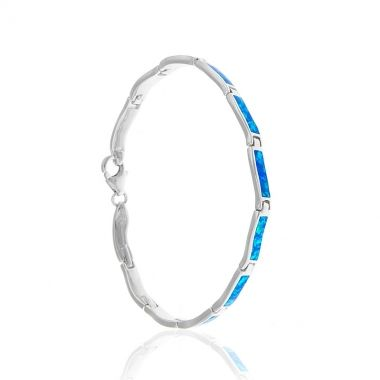 A sterling silver bracelet featuring twelve rectangular links in 925 silver with blue opal inlay. A delicate and captivating bracelet that bubbles with shimmering elegance. The rectangle pieces of blue opal magically reflect the different colours of the Ionian sea. This dazzling piece of silver jewellery is bound to attract attention wherever you go. Match it with similar delicate blue opal sterling silver bracelets and add more colour to your business attire.