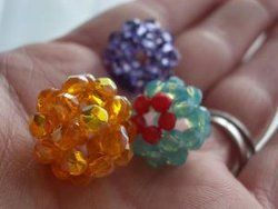 I want to make some of these...I think I would use some of my tiny beads and then use them on a changeable watch band.....could be really fun!