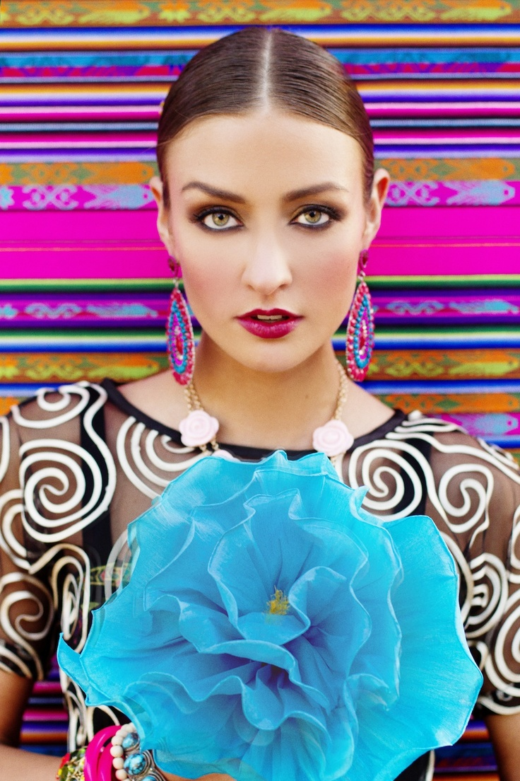 Cinco de Mayo editorial, Spanish and Mexican inspired fashion photo shoot, colorful, bright, mixed patterns, floral headbands, flowers in hair, big earrings, Frida Kahlo inspired shoot