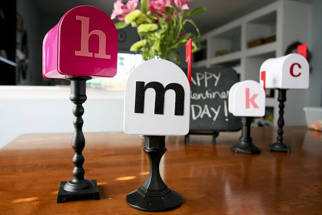 Dollar store mailboxes and candlesticks painted black. Cute idea for Kids Valentine's... my kids already have some but I love the stand idea!