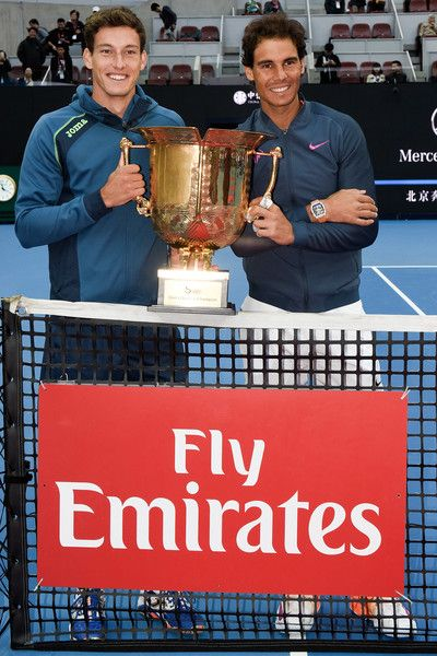 Rafael Nadal of Spain and Pablo Carreno Busta of Spain hold the winners trophy after winning the Men's Doubles final against Jack Sock of the United States and Bernard Tomic of Australia on day nine of the 2016 China Open at the China National Tennis Centre on October 9, 2016 in Beijing, China.