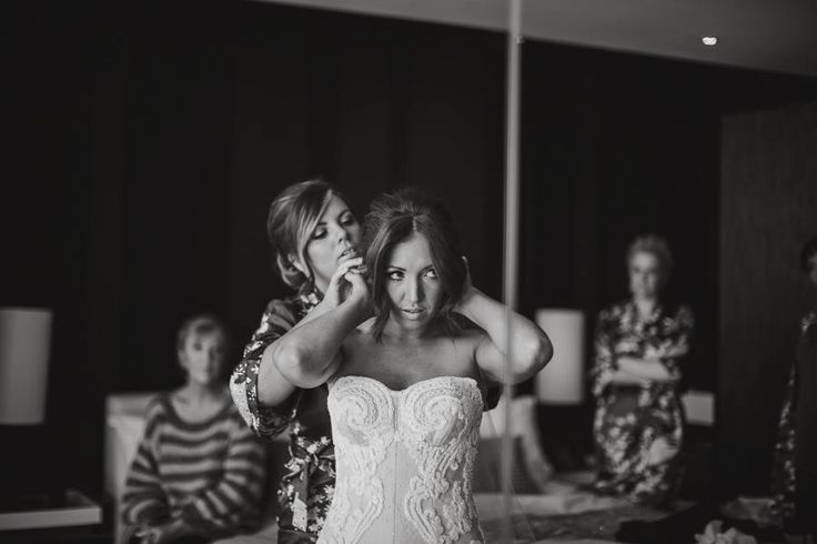 Matron of honour pinning the veil. Special Moment  Shane and Jess's Melbourne town hall ceremony & Abbotsford convent wedding Dress: Catherine R Couture Photography: Darin Collison