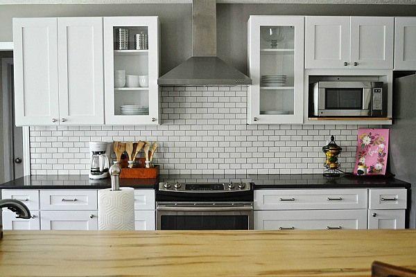 Subway tile kitchen & wood countertop!