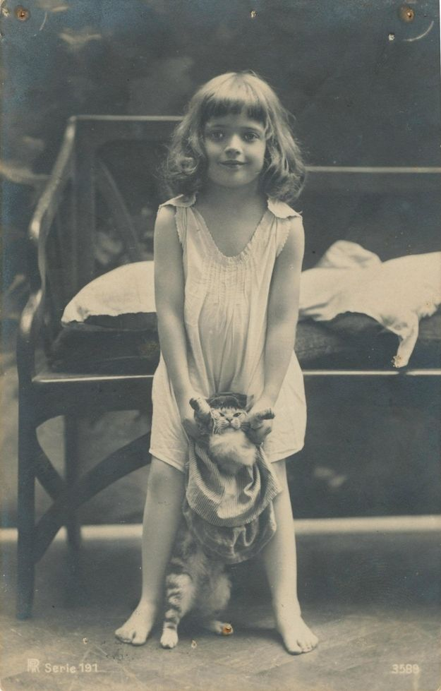 "43 Vintage Photographs That Prove Cats Are A Girl's Best Friend How many cats have had to play ""dress up""?"