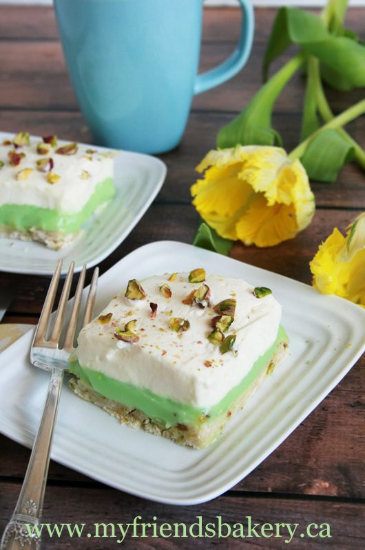 Three layer pistachio pudding cake for a delicious Mother's Day dessert.