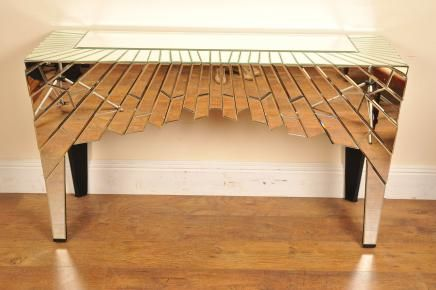 Funky Mirrored Console Table Deco Hall... can't afford it now, but damn, that girl has some great lines.