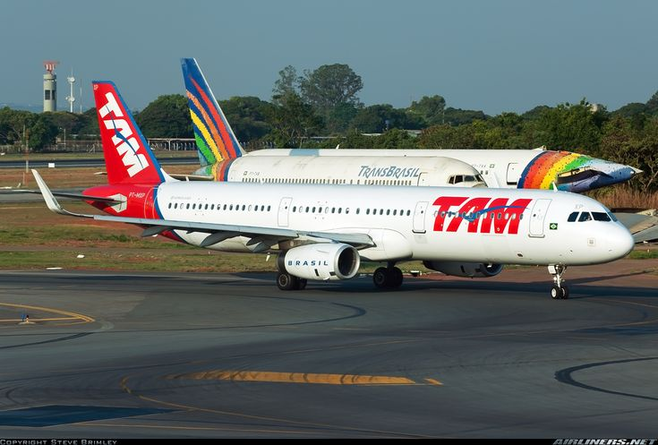 TAM Linhas Aéreas Airbus A321-231 PT-MXP at Brasília-International, October 2015. PT-MXP passes by two relics of another era: TransBrasil Boeing 767-2Q4 PT-TAB and a tail-less TransBrasil Boeing 767-2Q4 PT-TAA. Both have been stored at Brasília and slowly cannibalised for parts since the collapse of TransBrasil in December 2001. (Photo: Steve Brimley)