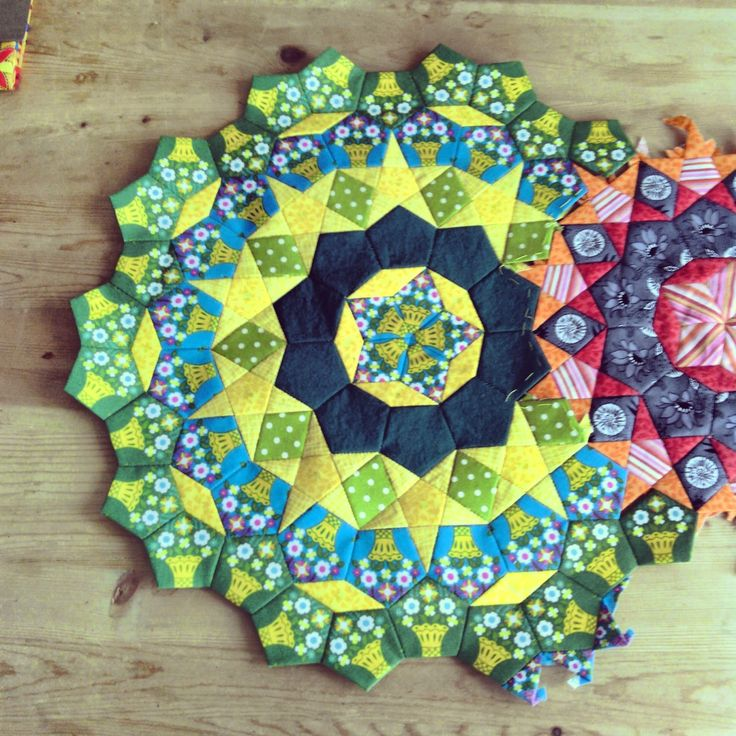 Another Millefiori quilt in progress. This photo shows how the pieces connect. Paper Piecing: cogs for the Passacaglia quilt