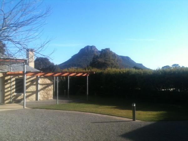 Royal Mail Hotel courtyard with Mt Sturgeon in the background on a Winter's day.