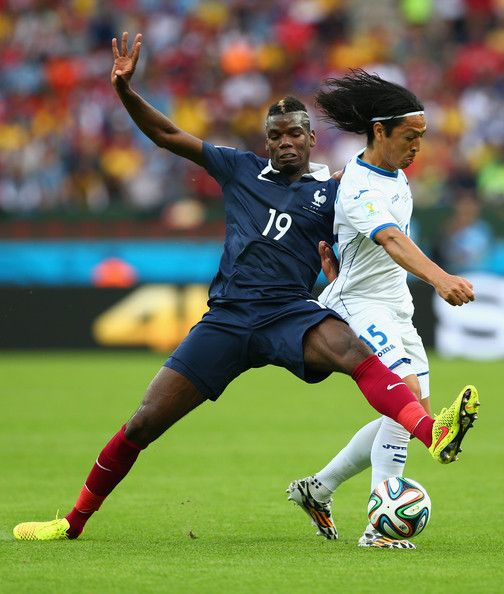 Paul Pogba of France challenges Roger Espinoza of Honduras during the 2014 FIFA World Cup Brazil Group E match between France and Honduras at Estadio Beira-Rio on June 15, 2014 in Porto Alegre, Brazil.