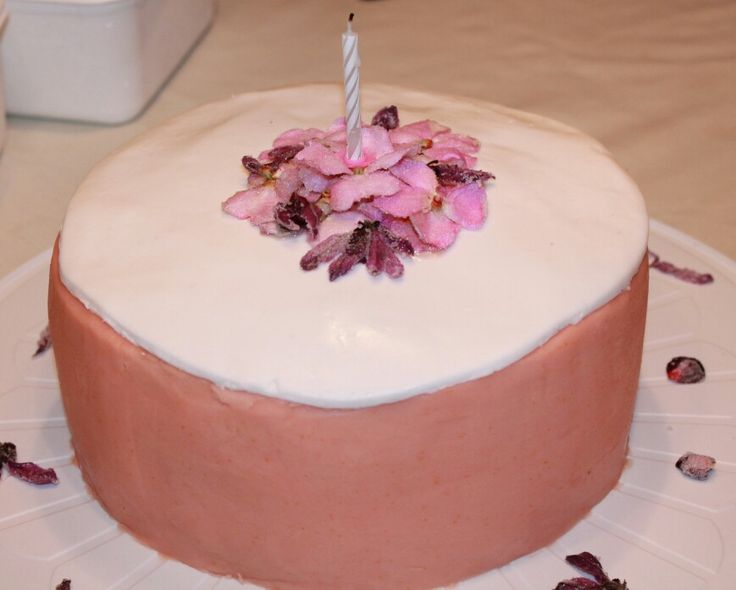 Real edible sugar coated flowers top this birthday cake - 4 layers!