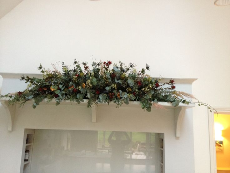 For Mantle Piece Arrangement I used Eucalyptus, Eryngium, Mimosa, Wax Flowers and Ivy
