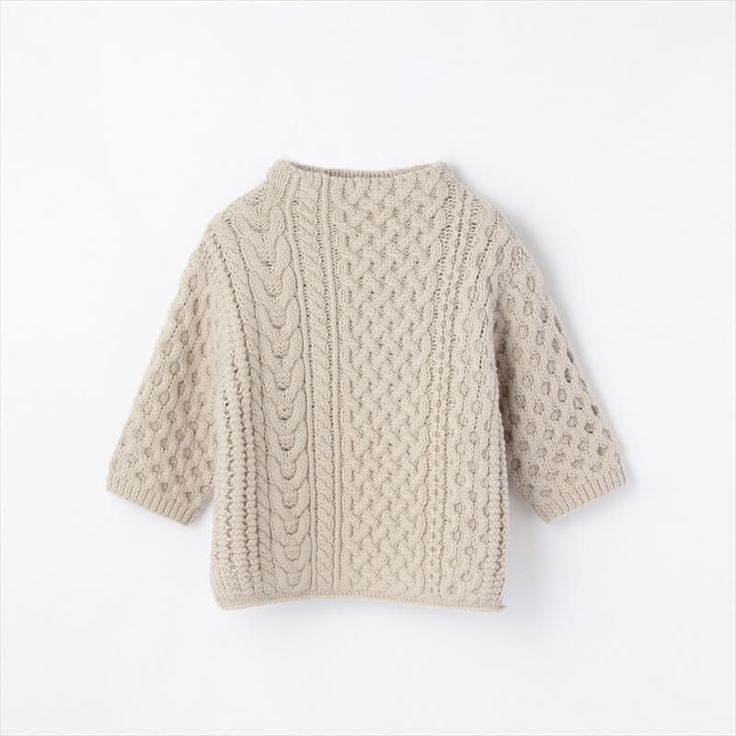 I love everything about this sweater. The off center cables, the funnel neck, and the relaxed shape. So chic.