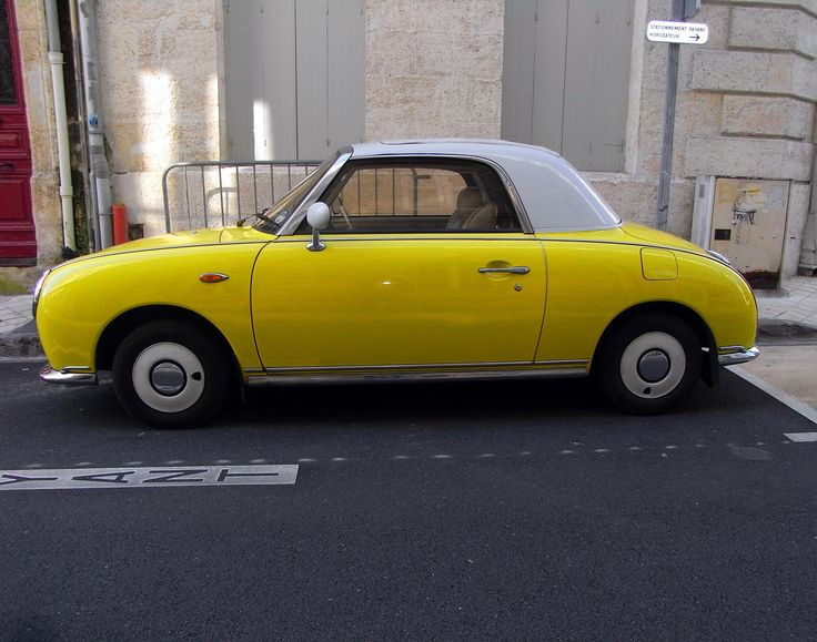 nissan figaro, lots of these odd looking cars in London